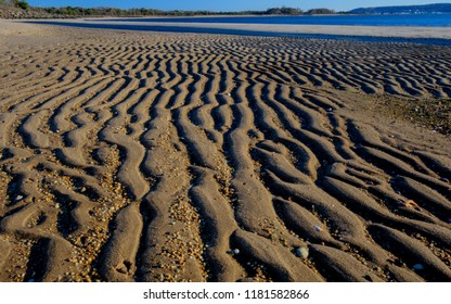 Ripples in the beach sand at low tide in Sandy Hook National Recreation Area in Highlands, New Jersey