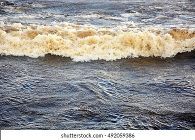 Ripples on the ocean water at the wind. Background, texture