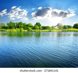 Ripples on the river at sunny summer day