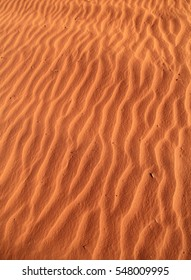 Ripples in red sand on a dune in the desert of outback central Australia.