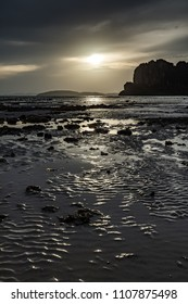 Ripples of sand on one of Krabi (Thailand)'s beaches during sunset.