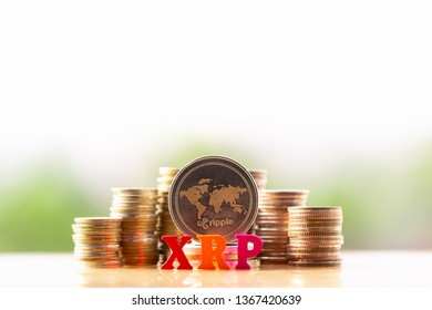 Ripple(XRP) and wooden block XRP on greenery nature background. virtual cryptocurrency mining concept. cryptocurrency news. BTC. ETH. XRP