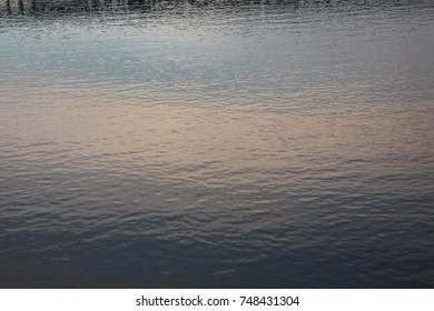 Rippling water on the Tennessee River with reflecting sunset colors in the river