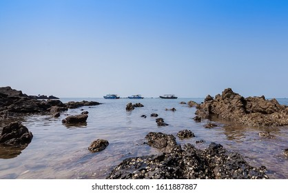 Riprap and fishing boats by the sea