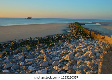 Riprap on the beach of Le Portel, France, on the opal coast