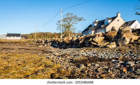 Riprap rock acting as a coastal sea defence from erosion on a cobble beach in Scotland