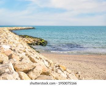 Riprap or rock armour structure for protecting the sea coastline. Black sea waterfront in Constanta, Romania.