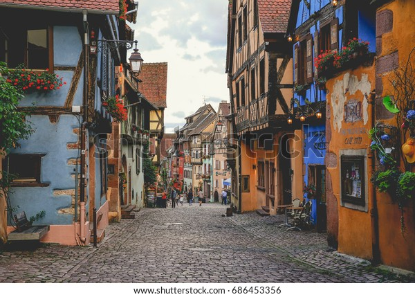 RIQUEWIHR, FRANCE - July 11, 2017: Main street houses in the beautiful french village in Eastern Alsace, France