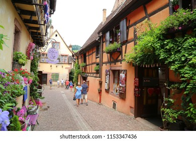 Riquewihr, France - July, 12, 2018: tourist waling in the street of the medieval village