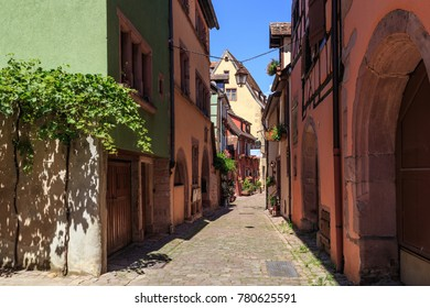 RIQUEWIHR, FRANCE - JULY 17, 2017: Picturesque street with traditional colorful houses in Riquewihr village on alsatian wine route, Alsace, France.