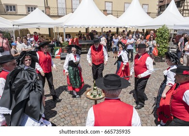 RIQUEWIHR, FRANCE, JUNE 2017: Traditional folk dancers celebrating the famous Riesling wine.
