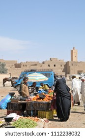 Risani, Morocco - march 20, 2012: Women dressed in black jilbab buying vegetables at the rural market in the city