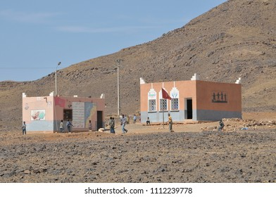 Risani, Morocco - march 20, 2012: Buildings of a nursery school in the arid landscapes of the Zagora region, near the desert