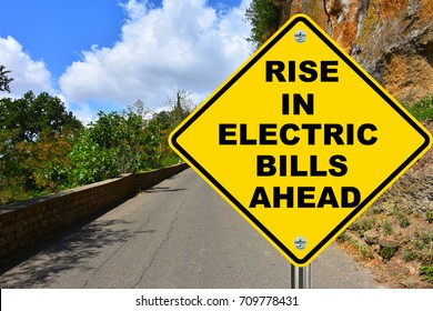 Rise in electric bills ahead yellow warning road sign