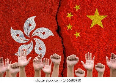 Rise up hand with China and Hong kong flags print screen on wall cracked.Hong kong people protestor concept.