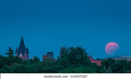 Rise of the moon - lunar eclipse over Halle Saale in Germany