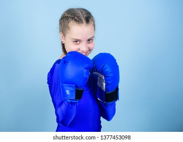 Rise of women boxers. Female boxer change attitudes within sport. Feminism concept. With great power comes great responsibility. Boxer child in boxing gloves. Girl cute boxer on blue background.