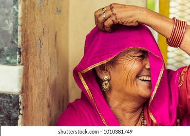 Rishikesh, India - 11/03/2017: Portrait of a wise looking Indian elderly woman in traditional saree dress
