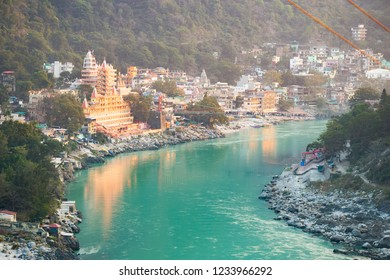 RISHIKESH - INDIA - 27 DECEMBER 2017. Spectacular view of the Lakshman Temple bathed by the sacred river Ganges at sunset. Trayambakeshwar is one of the important holy shrines in Rishikesh, India.