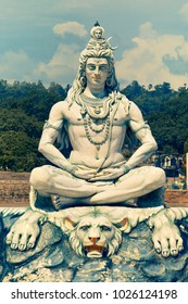 RISHIKESH, INDIA - AUGUST 29: Statue of Lord Shiva on Ganga Ghat of river Ganges on August 29, 2012 in Rishikesh