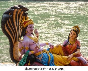 Rishikesh, India - Circa March 2018. Beautiful statues of Lord Vishnu and Lakshmi at the Ganga riverbank in Rishikesh.