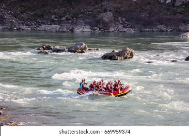 RISHIKESH, INDIA - MARCH 13, 2017: Two boat drive through the rapids of the Ganges at Rishikesh, India.
