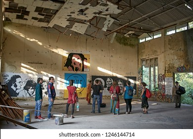 Rishikesh, India, November 2015. Tourists visiting the ruins of Chaurasi Kutia, better known as The Beatles ashram.