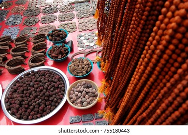 Rishikesh, India - November, 4th, 2017. Old coins and rudraksh on the street market in Rishikesh