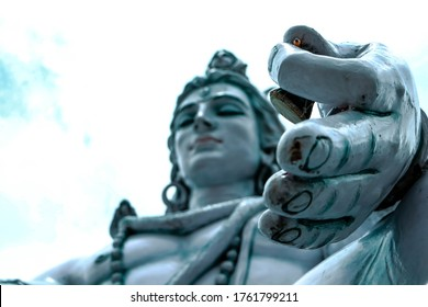 RISHIKESH, INDIA , Statue of Shiva, Hindu idol near Ganges River water, Rishikesh, India. The first Hindu God Shiva. Sacred places for pilgrims in Rishikesh