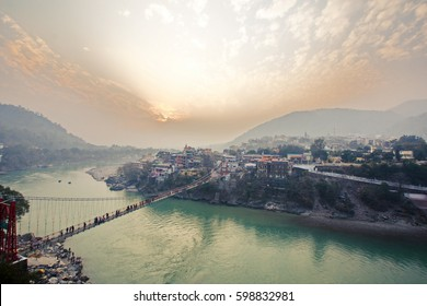 Rishikesh, yoga city ashram sanctuary India Asia at sunset Ram Jhula, Ganges  valley