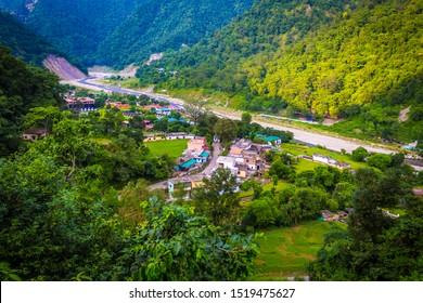 Rishikesh, Yoga city India, Ganga River valley, Sunrise Uttarakhand. River rafting Landscape of mountains in Rishikesh along side river Ganga flowing in the monsoon season in Uttarakhand, India. Image