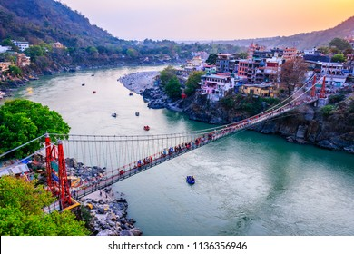 Rishikesh, yoga city India, Ganges River Ganga Ram Jhoola (Bridge).People enjoying rafting