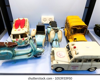 RISHON LE ZION, ISRAEL- DECEMBER 17, 2017: Retro toy car in the store. Nostalgia and simplicity. A children's retro car is on store shelves. Vintage toy car.
