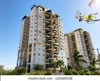 RISHON LE ZION, ISRAEL -December 4, 2018:  Residential building and palm trees  in Rishon Le Zion, Israel.