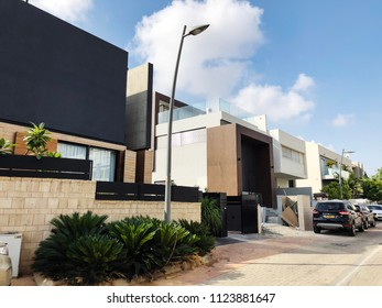 RISHON LE ZION, ISRAEL -  JUNE 28, 2018: Private modern houses on the streets in Rishon Le Zion, Israel.