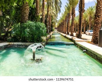 RISHON LE ZION, ISRAEL -JUNE 18, 2018: Fountains in city park  in Rishon Le Zion, Israel