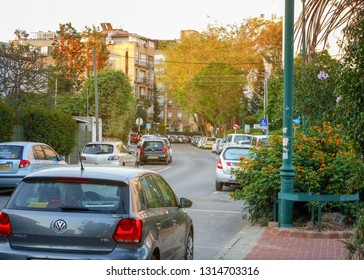 Rishon LeTsiyon, Israel-April 29, 2013:Typical middle 20th Century street in the living neighborhood of the Israeli downtown with 4 story yellow plastered facade houses.