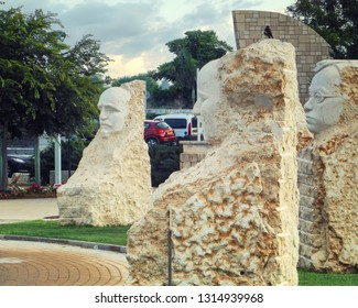 Rishon LeTsiyon, Israel-August 21, 2013: Monuments to founders of Israel in Ha-Manhigim Garden. The faces carved in the whole piece of limestone.