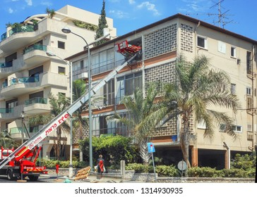 Rishon LeTsiyon, Israel-August 7, 2013: An elevator extends its boom to the window of the 3rd floor to carry out family's belongings removal.