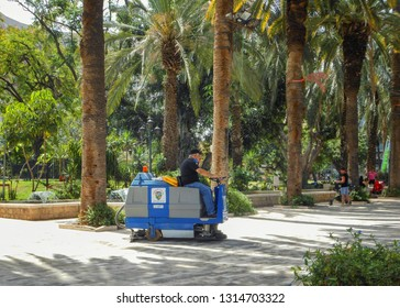 Rishon LeTsiyon, Israel-June 2, 2013: Mechanical cleaning vehicle cleans the alleys of the central park. The small size of the sweeper allows reaching and cleaning confined places.