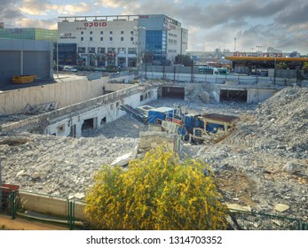 Rishon LeTsiyon, Israel-March 17, 2013: Final demolition of badly built mall Aristocrat in the Western Industrial Zone is at the close-up view. The Muscat event hall is at the background.