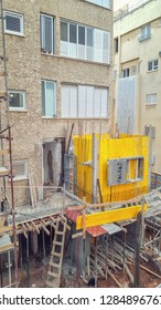 Rishon LeTsiyon, Israel-March 28, 2018: Restoration of and building up an old living house with the help of mounting molds and casting concrete walls of the additional compartment.