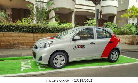 Rishon LeTsiyon, Israel-May 10, 2018: A grey hatchback with a red stripe on the back door is a Car2Go sharing vehicle. It stands on the special spot in front of a residential building.