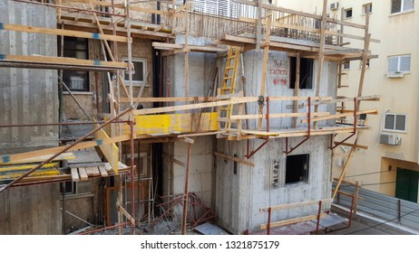 Rishon LeTsiyon, Israel-May 19, 2018: Erection of the 2-floor Mamad, the apartment-protected space. The concrete walls have already been cast. Temporary wooden railings are along the staging catwalk.