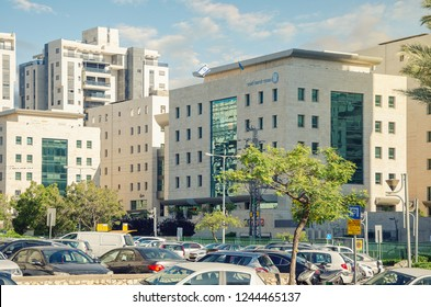 Rishon LeTsiyon, Israel-May 26, 2017: View of public parking full with cars opposite the official building of Bituach Leumi. It is Israel's national social security agency.