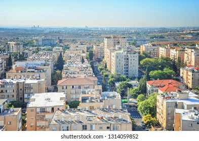 Rishon LeTsiyon, Israel-October 4, 2011: Aerial view at urban development of typical Israeli city in 70-80-s last century. The 4 story buildings prevail at the left and 8 story buildings at the right