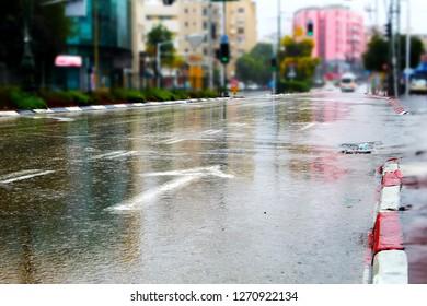Rishon LeZion, Herzl Road. Major street in Rishon LeZion, entrance to the city, wet road, rain. Winter in Israel