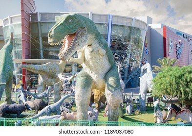 Rishon LeZion, Israel-April 25, 2017: Park of Dinosaurs consists of most recognizable species of Jurassic period. The natural size sculpture of Tyrannosaurus rex stands in front of the Cinema city