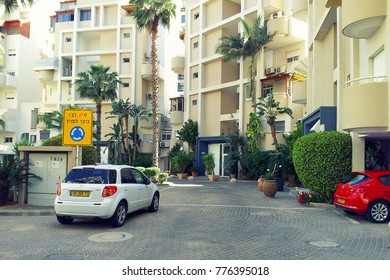 Rishon LeZion, Israel-April 26, 2015: View of green semicircle courtyard of condominium compound located at Ha-Botsrim Street. Contemporary multi-story residential buildings are enclosed it. Sunny day