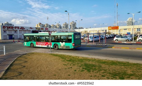 Rishon LeZion, Israel-February 10, 2016: Green bus of Egged company arrives central bus station in the city located 6 Hahistadrut Street. It is 2-story building with shops inside and big parking lot